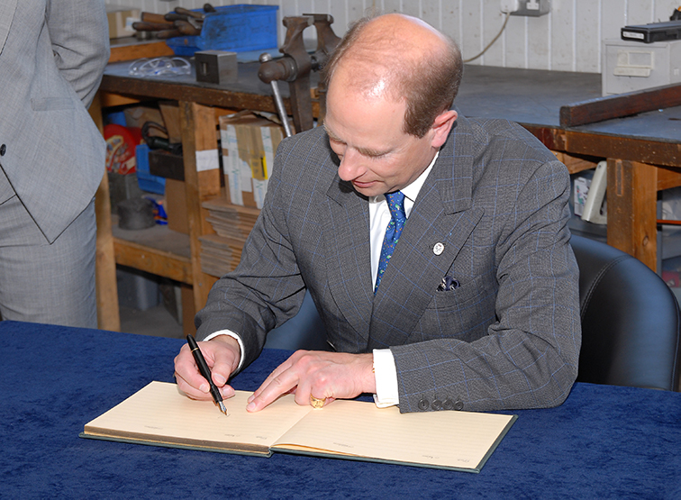 Prince Edward signs book